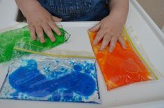PINCH BAGS •  When you pinch them the coloured water separates. I find them amazing for focused discovery. 1/3 water, two drops of food dye and 1/3 baby oil. We always have them on the change table for those extra wriggly nappy change moments.