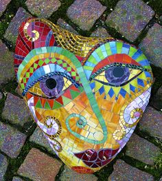 "mosaic for a stepping stone or as garden art  --  Stone mask ""Melancholy"" by Herzstücke Mosaic Masks, via Flickr"