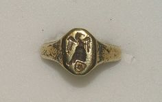 Signet ring 14th/15th century Gold signet ring, the octagonal bezel engraved with a crest of a Venetian nobleman bearing a rose of five petals surmounted by a helmet with a lambrequin and crested with a demi-eagle displayed, the shoulders nielloed with dragons 19.15 mm internal ring diameter; 8.62 g weight