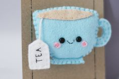A one of a kind cute blue teacup felt brooch ready to be worn on your jacket, bag or anywhere youd like! Features a teabag with a heart on one side