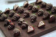 where decadent meets dessert...Chocolate covered tuxedo strawberries. #wedding #eventcatering #catering #thetinkitchen