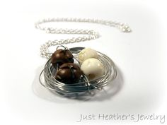 $23 - www.etsy.com/shop/JustHeathersJewelry - Bird's nest necklace - wire wrapped - carved brown and ivory beads - birdnest - robins egg nest - bone - wood - gift idea - handmade. Use coupon code PINS15 for 15% off your total purchase.