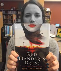The Red Mandarin Dress by Qiu Xiaolong is today's #bookfacefriday! #syosset #library #bookface #bookcovers #nypl #syossetbookface #mysterybooks #fiction #crimefiction #books #reading #redmandarindress @stmartinspress #minotaurbooks