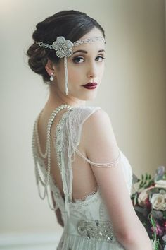 In the 1920s, beauty was extreme and women started to experiment with their hair and make up. A bow-shaped dark lip with lashings of mascara and blusher will give you the look. Source: chicvintagebrides.com #vintagemakeup #vintageweddings