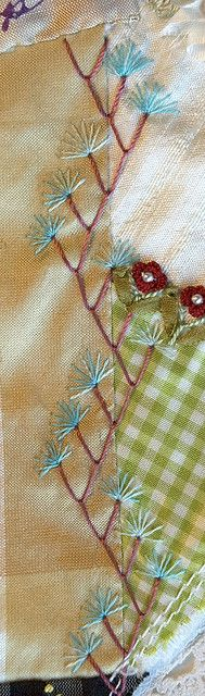 Love the red turkey stitch with the blue  puff flowers