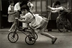 Little girl scooting along on a tricycle, Tokyo, Japan, photograph by Colin Jones. Vintage Children Photos, Vintage Photos, Monochrome Photography, Street Photography, Showa Era, Famous Pictures, Bicycle Race, Nihon, Black And White Pictures