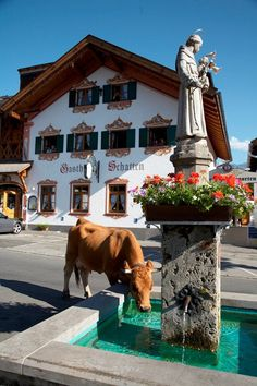 St. Anthony Statue in front of Gasthof Schatten in Partenkirchen. Repinned by www.mygrowingtraditions.com
