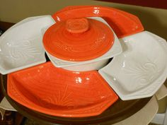 Seven Piece California Pottery Lazy Susan, orange and white