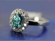 Fashion Ring - 18KW GEMS OF DISTINCTION RING WITH 2.49CT BLUE ZIRCON AND  .70CT DIAMONDS