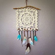 Crochet wall hanging done! #crochet #crochetdreamcatcher #dreamcatcher Link to pattern: http://www.ravelry.com/patterns/library/dreaming-of-granny-granny-square-wall-hanging-homdec010