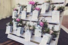 wedding table plan flowers in buckets on wooden pallet (2)