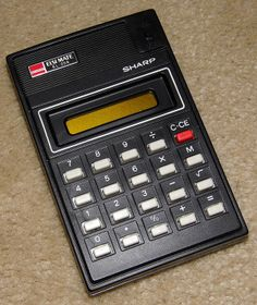 Vintage Sharp Elsi Mate Model EL-206 Electronic Pocket Calculator, An Early Calculator Using An LCD (Liquid Crystal) Display, Made In Japan, Circa 1979.