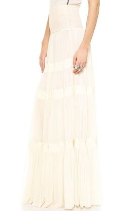 Ribbed wool stripes lend a tiered look to this soft mesh Jean Paul Gaultier maxi skirt. Wide waistband. Double-layered.