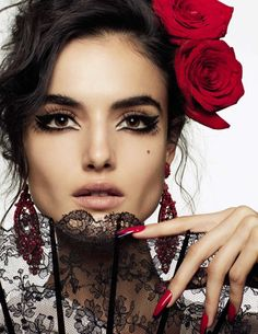 Gracing the pages of Vogue Spain's March 2017 issue, Blanca Padilla appears in a gorgeous beauty spread. Photographer Miguel Reveriego captures the Spanish beauty in dramatic makeup looks inspired by the late Lola Flores. Lace and floral blooms take the spotlight. From winged eyeliner to red lipstick shades, Blanca stuns in each shot with makeup …