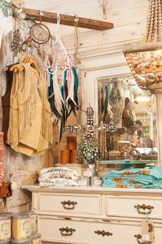 Setting Up the Junk Gypsy Store | Junk Gypsies | GAC ~ Awesome way to do a slower, like it's your own personal store. LOVE the wooden beaded chandelier. Would be perfect to paint antique white or crackle white & hang in the closet, perfect way to fake a chandelier!