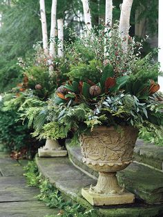 Urns with greenery, fruit and birch sticks.