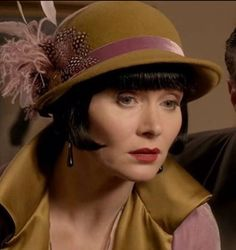Miss Fisher's Murder Mysteries - this is slightly brighter. Chartreuse and mauve