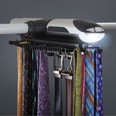 This is the motorized tie rack that allows the well-dressed gentleman to efficiently browse a large selection of neckties. How To Look Rich, How To Make, Tie Storage, Design Innovation, Tie Organization, Tie Rack, Diy Gifts For Him, Hammacher Schlemmer, Men Style Tips