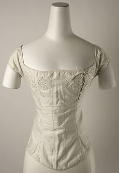 Cotton corset 1820–30, American - in the Metropolitan Museum of Art costume collections. No chest gussets, but lacing is used on the left to close the corset - in addition to the usual lacing at the back.