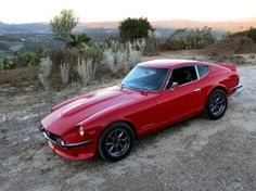 240z = I will have this in my garage one day......