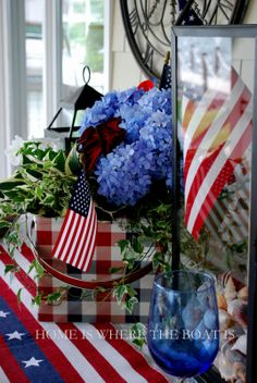 Red, White & Blue centerpiece with flags, blue hydrangeas and lanterns  | Home is Where the Boat Is #july4th #memorialday #patriotic #flag
