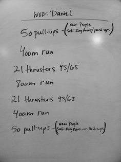 50 ups, 1/4 mile, 21 over head weighted thruster, 1/2 mile, 21 thrusters weighted, 1/4 mile, 50 push ups