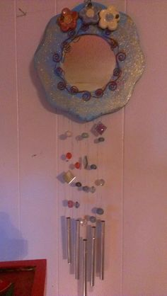Painted wind chime mirror.