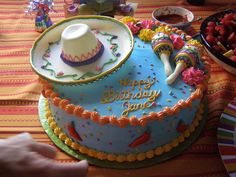 Fiesta birthday cake.The hat is made out of candy clay.