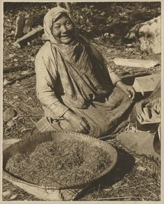 Ojibwe woman with container of wild rice, 1940. Known as manoomin in the Ojibwe language.