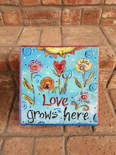 Garden Stone, Stepping Stone, Love grows here art ideas stepping stones Garden Stone, Stepping Stone, Love grows here Painted Stepping Stones, Painted Pavers, Painted Rocks, Hand Painted, Painted Tiles, Painting Concrete, Stone Painting, Brick Crafts, Concrete Crafts