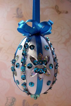 White Satin with Silver Almond Shapes and Turquoise Sequins Easter Egg Ornament by Ornament Designs