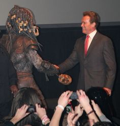 And now, Arnold Schwarzenegger cordially shaking hands with the Predator