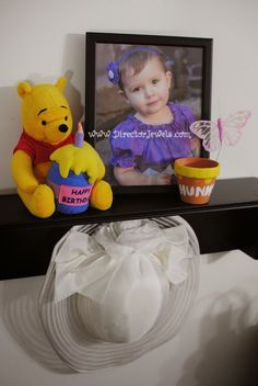 Disney Winnie the Pooh Birthday Tea Party Decorations and Theme for Toddlers. 2nd Birthday Party Ideas. Come to tea with Piglet, Eeyore, Rabbit, Owl, Christopher Robin.