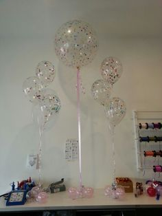 "Confetti filled balloons. Crystal clear 3ft and 11"" stuffed with rainbow confetti"
