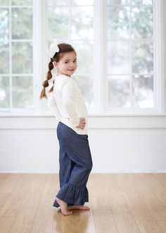 Our Single Ruffle Chambray Denim Pants are the perfect pair of jeans!  The comfortable elastic waist provides an easy fit.  These are perfect for dressing up any top or tunic.   Fabric Content:  100% Cotton Please check measurements before ordering.  All sales are final.  No returns or exchanges.  https://adorableessentials.com/collections/denim/products/single-ruffle-chambray-pants?variant=6608939333
