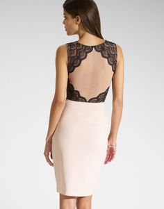 How stunning is the back of this lace and nude dress!?