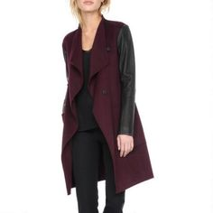 Soia Kyo Wool Coat w/ Leather Sleeves $529.99                      Our Price Now:                                           $600.00                      Comp Value Was:
