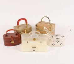 """Collection vintage purses; four plastic/lucite handled bags, longest marbled cream lucite is Saks Fifth Ave, the other is Llewellyn NYC, caramel lucite is Milgrim, one patent leather marked Rosenfeld, one faux ostrich marked Delill, longest 12"""". Good condition."""