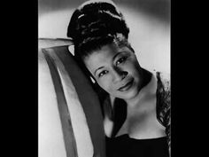So In Love by Cole Porter sung by Ella Fitzgerald.  Listen to the half steps and minor notes in this song.