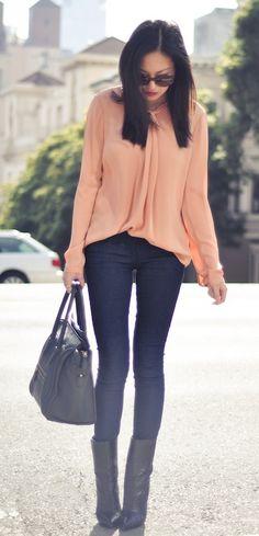 peach blouse. skinny jeans. boots. handbag.