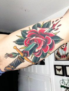 Traditional rose & dagger on inner arm. By Grez at Kings Ave Tattoo; New York, NY.