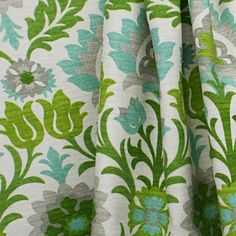 From the Sun & Shade collection by Waverly is a fresh floral fabric in mint-aqua and kelly green, with grey and cream. This medium upholstery weight fabric