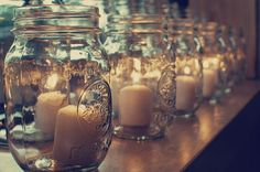 candles in mason jars sitting all around the house and in amount the food