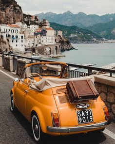 A open air tour through the scenic Campania region of Italy in a 1960 Fiat 500 convertible designed by Dante Giacosa. Summer Aesthetic, Aesthetic Vintage, Travel Aesthetic, Aesthetic Yellow, Beach Aesthetic, Photo Wall Collage, Picture Wall, Retro Cars, Vintage Cars