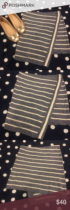 Free People Striped Asymmetrical Skirt A blue/gray and white striped skirt that is asymmetrical and is like a soft sweater material. Super cute for any occasion. Worn once and in good condition. Free People Skirts Asymmetrical