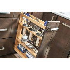 $270.99 · Rev-A-Shelf's beautiful base organizers feature adjustable shelves with chrome rails to help keep everything in its place. Stop digging through drawers for utensils and say goodbye to unsightly, space monopolizing counter bins with the 448UT pullout designed specifically for storing a multitude of utensils. Units glide out on the Blumotion soft-close slide system, which is some of the industry best slides. Door mounting is easy with their patented door mount brackets that p..