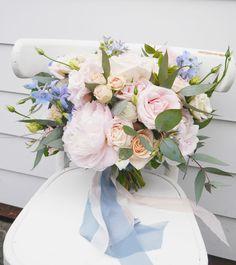 Blush and blue bouquet featuring blush peonies, roses, lisianthus and blue belladonna, with trailing gum. www.blossomweddingflowers.co.nz