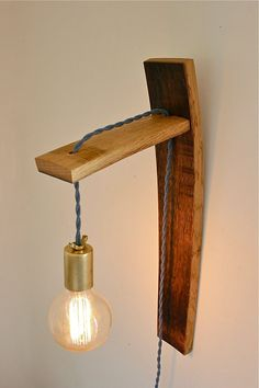 salvaged oak wine barrel wall sconce // rustic modern industrial lighting // exposed edison bulb // brass and reclaimed wood on Etsy, $167.00