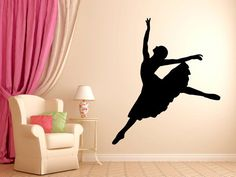 The silhouette of dancing ballerina wall decal, along with the massive pink curtains, transforms the wall to a stage and the living room to a theater