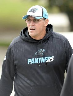 Carolina Panthers head coach Ron Rivera walks to the team's practice facility on Tuesday, October 13, 2015.